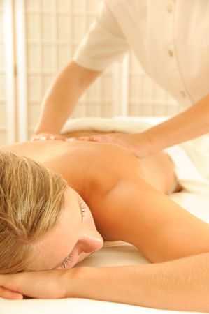 Beautiful woman in a spa with massage therapy photo