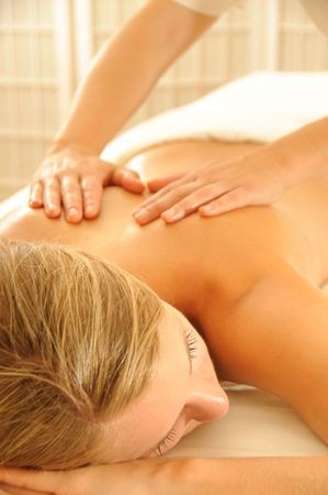 massage therapy: Beautiful woman in a spa with massage therapy