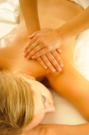 Beautiful woman in a spa with massage therapy
