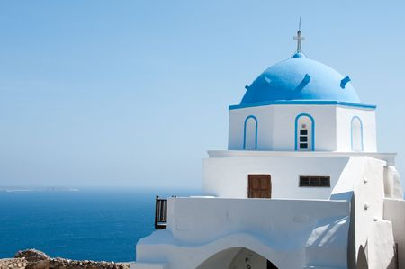 Greek church in santorini greece with a cross photo