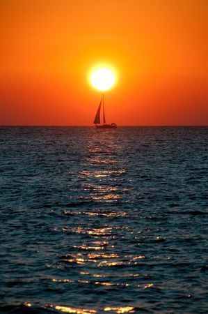 Sunset colors over the ocean sea sail boat