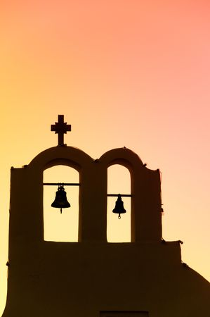 Greek church in santorini greece with a cross