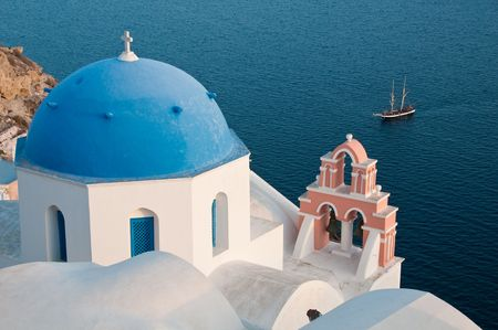 Greek church in santorini greece with a cross