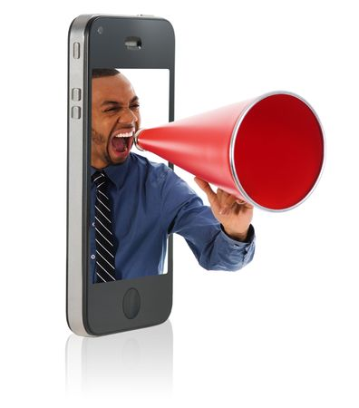 Businessman yelling in a red megaphone from a mobile phone Stock Photo