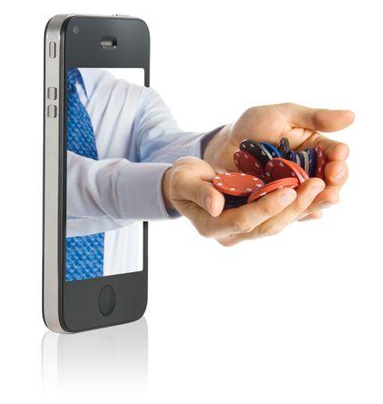 fichas casino: Poping de manos de un tel�fono inteligente con fichas de casinos