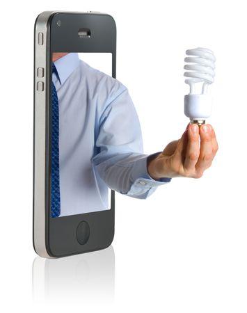 A hand holding a compact fluorescent light bulb