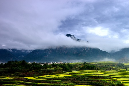 The rural scenery view of a mountain with cloud