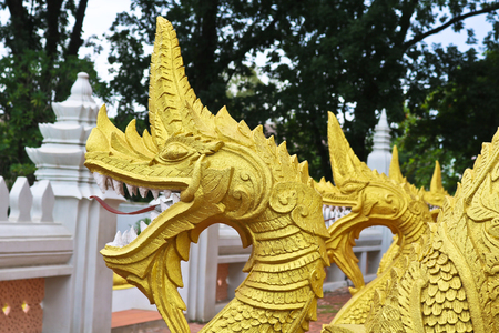 Golden Naga ladder sculpture in Lao temple, Laos Stock Photo
