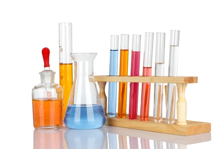 Laboratory glassware with reflections over white background photo