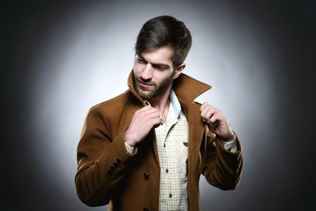 Man correct collar coat whith dark bakground