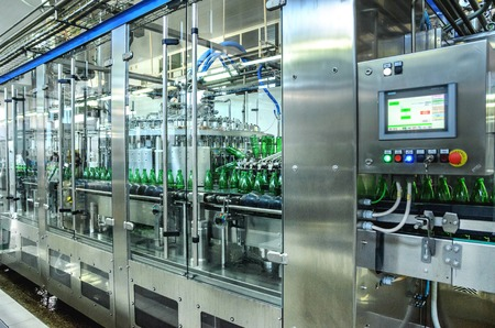water green bottling plant. Industrial conveyor of mineral water. process equipment Stok Fotoğraf
