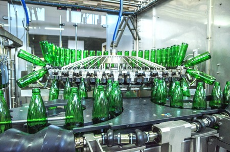 water green bottling plant. Industrial conveyor of mineral water. process equipment Stock Photo