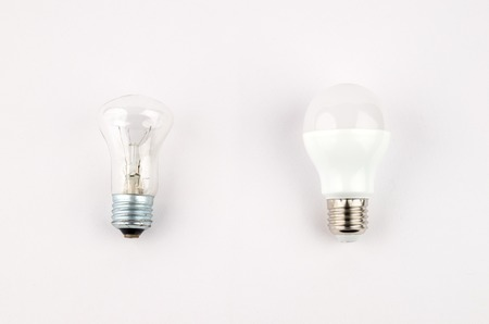 several LED energy saving light bulbs over the old incandescent, use of economical and environmentally friendly light bulb concept Imagens