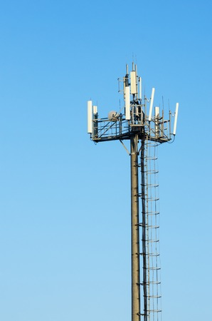 Antenna cellular networks against the blue clear sky Stock Photo