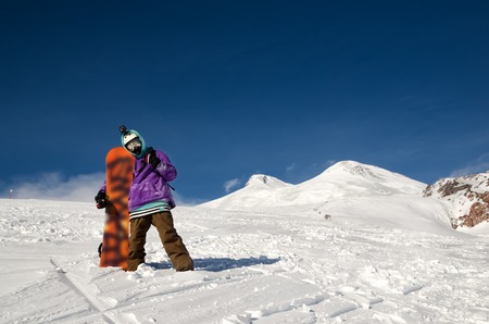 ski walking: Snowboarder stands and walks on mountain slopes of an extinct volcano Elbrus