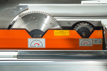 build buzz: Circular toothed blades Elements A precision circular saw cutting machine Stock Photo