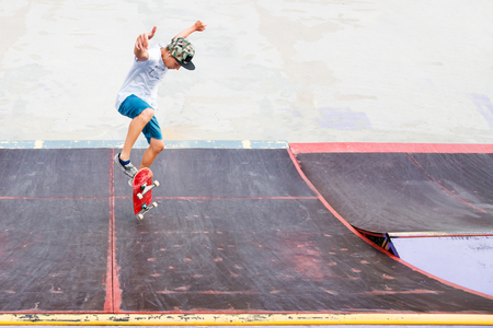 Young boy doing the trick on the ramp Stock Photo