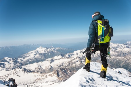 Professional guide - climber on the snow-covered summit of Elbrus sleeping volcano Stock fotó - 83883918