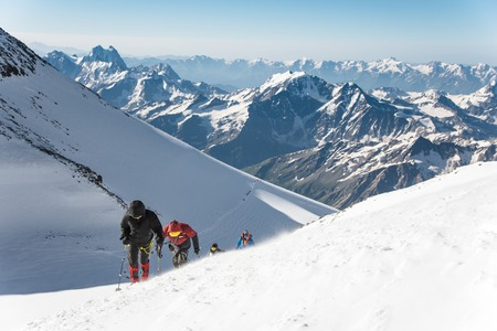 High-altitude tourists climb the mountain