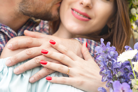 close-up of a hands hugging couple of guy and his girlfriend