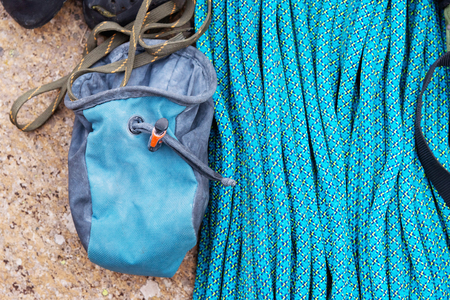 Climbing equipment - A bag for magnesia lies on a climbing rope