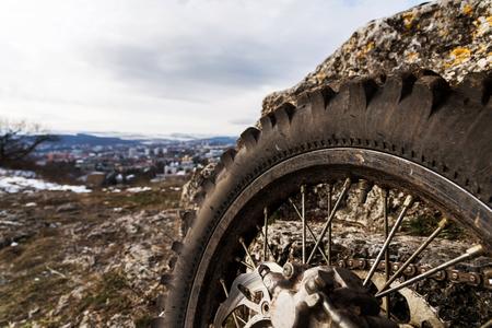 Wheel with spokes and brake disc plus Enduro motorcycle chain.
