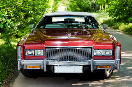 NEVINOMYSSC, RUSSIA - MAY 13, 2016: Automobiles. Offsite photography of old American cars. Cadillac Eldorado Convertible 1976s. Machine type from the front on a country road in a forest
