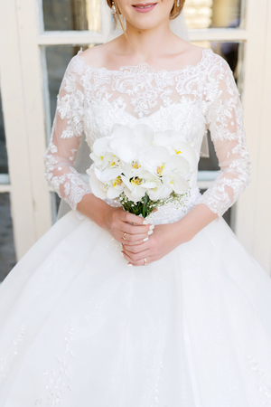 close-up of a bride holding a wedding bouquet