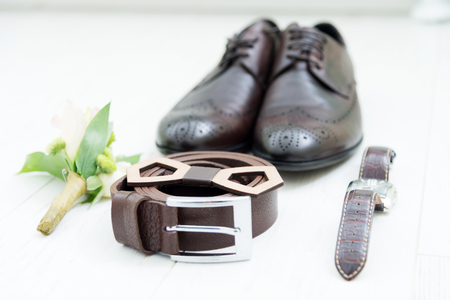 Mens accessories of the groom at the wedding are exposed by a still-life on a light laminate. Stock Photo