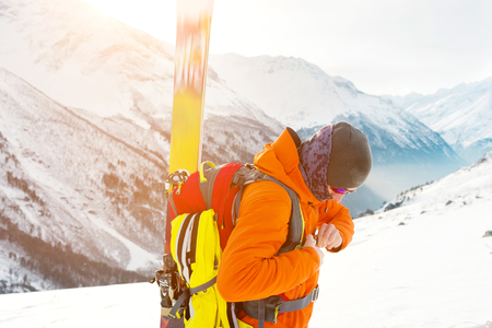 A close-up portrait of a freeride skier on the climbing track for freeride-descent. Stock Photo