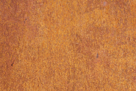 Rusty yellow-red textured metal surface. The texture of the metal sheet is prone to oxidation and corrosion. Grunge background 版權商用圖片