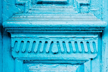 Close-up the Element of blue many times painted cracked double-barreled wooden vintage door of the last century with a post slit. Stock Photo
