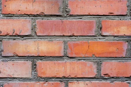 Textured background red brick wall with traces of old age and with different shades of bricks. Brick manual curve masonry and different color Foto de archivo - 95919878