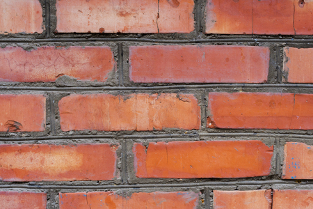 Textured background red brick wall with traces of old age and with different shades of bricks. Brick manual curve masonry and different color Foto de archivo - 95749042