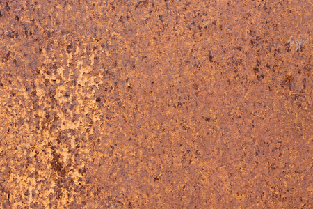 Rusty yellow-red textured metal surface. The texture of the metal sheet is prone to oxidation and corrosion. Grunge background Stock Photo