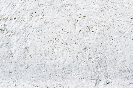 Close-up Deep texture of white-painted porous stone on the facade of the building. Stoned wall background texture Stock Photo