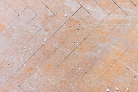 A close-up of an old faded parquet covered with dust and dirt. Result of repair. Cleaning and cleaning required