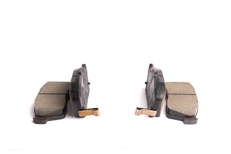 Set of 4 pieces of new front disc brake pads, isolated on white