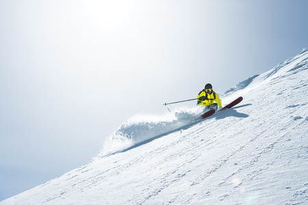 The total length of skiing on fresh snow powder. Professional skier outside the track on a sunny day Banco de Imagens - 103778358