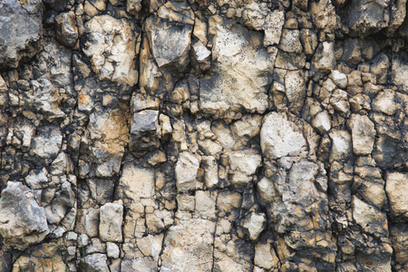 Textured stone background Rubble ballast in natural form in the rock wall