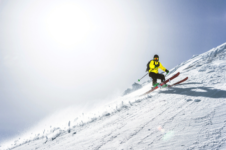 The total length of skiing on fresh snow powder. Professional skier outside the track on a sunny day Banco de Imagens - 107451964