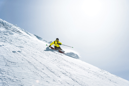 The total length of skiing on fresh snow powder. Professional skier outside the track on a sunny day Banco de Imagens - 108204712