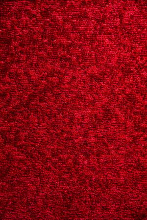 Texture of a dark red carpet. Close-up of gradient light. Reklamní fotografie