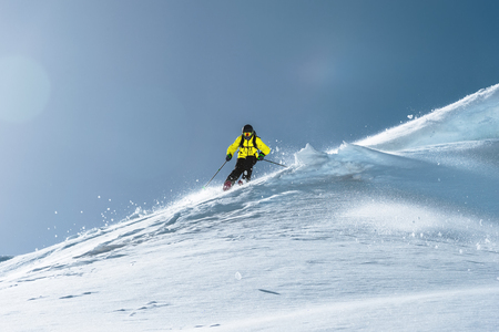 The total length of skiing on fresh snow powder. Professional skier outside the track on a sunny day Banco de Imagens - 108406680
