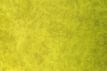Yellow patterned surface of velvet fabric on top. Texture of artificial cloth Stock Photo