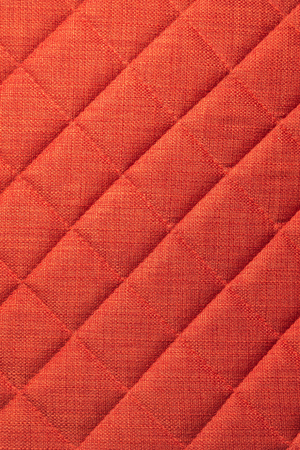 Close-up Furniture fittings - backrest upholstered sofa. Abstract red texture design