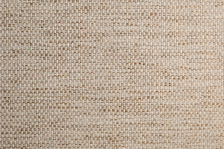 Textured background large beige textile. Texture of textile fabric close-up