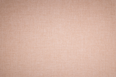 Textured background surface of textile upholstery furniture close-up. beige Color fabric structure