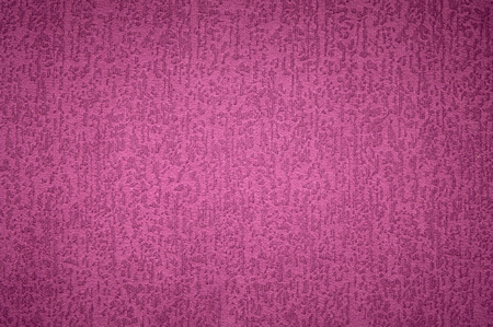 Textured background surface of textile upholstery furniture close-up. magenta red Color fabric structure Reklamní fotografie