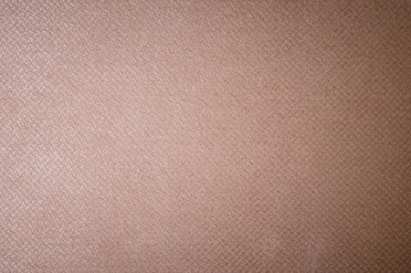 Textured background surface of textile upholstery furniture close-up. burlap beige color fabric structure